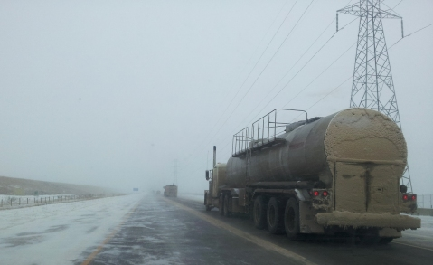 The highway up to the tar sands projects was snow-blown and littered with giant transport trucks.